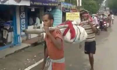 latest-news-no-vehicle-to-carry-her-body-so-odisha-staff-broke-it-at-the-hip