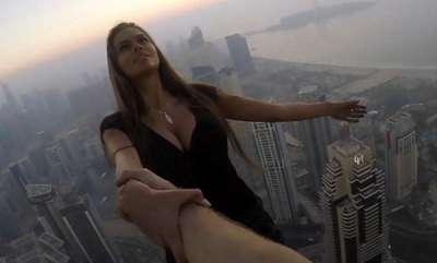 odd-news-stunning-russian-instagram-queen-dangles-off-a-1000ft-high-dubai-skyscraper-without-any-safety-equipment-as-she-seeks-the-perfect-shot
