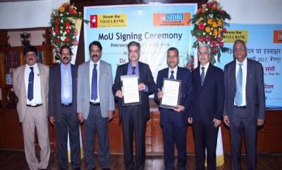 india-vijaya-bank-md-ceo-dr-kishore-sansi-and-sidbi-deputy-managing-director-sri-manoj-mittal-exchanges-the-memorandum