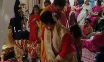 international-brides-dog-joins-indian-couple-for-wedding-pheras