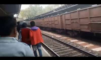 odd-news-viral-video-woman-gets-run-over-by-goods-train-and-survives