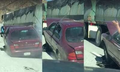 odd-news-driver-drags-a-car-wedged-under-the-back-of-his-big-rig-for-miles-down