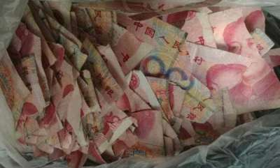 odd-news-chinese-boy-rips-dads-hidden-cash-worth-lakhs