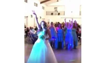 odd-news-video-courageous-bride-suffering-from-cancer-throws-off-wig-during-wedding