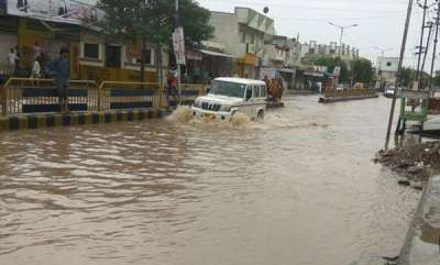 latest-news-floods-two-killed-in-rajastan-25000-people-evacuated-in-gujarat