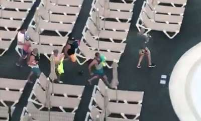 surprise-brit-tourists-filmed-sprinting-to-bag-sunbeds-nearest-swimming-pool