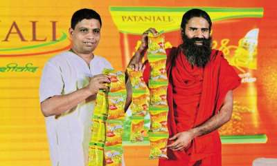 business-news-patanjali-ceo-among-top-10-richest-indians-with-70000-cr-wealth