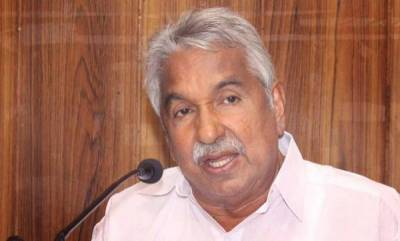 latest-news-oommen-chandy-criticizes-central-government-moves-to-change-passports-color