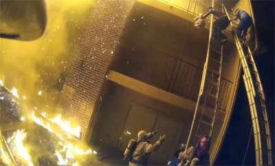 odd-news-fireman-catches-baby-dropped-from-burning-building