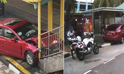 latest-news-singapore-woman-crashes-car-into-bridge-after-she-spots-a-cockroach-in-her-red-mazda