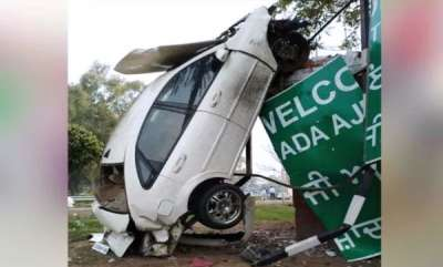 odd-news-crazy-car-accident-in-mohali-car-ends-up-climbing-a-pole