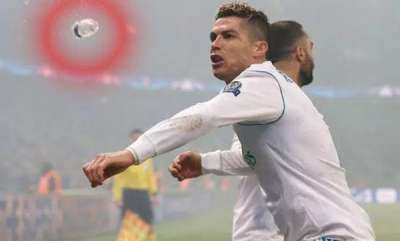 sports-news-real-madrid-ace-cristiano-ronaldo-inches-away-from-being-struck-by-bottle-as-he-celebrates-goal-vs-psg-in-heated-clash