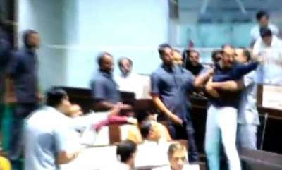 latest-news-ruckus-in-gujarat-assembly-as-congress-mla-throws-mic-at-bjp-member