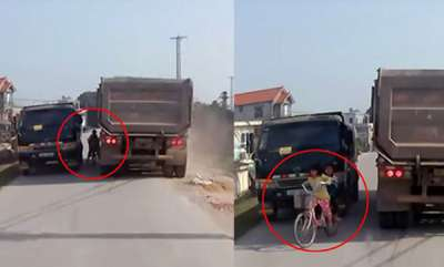 odd-news-kids-on-bicycle-nearly-hit-by-truck-video
