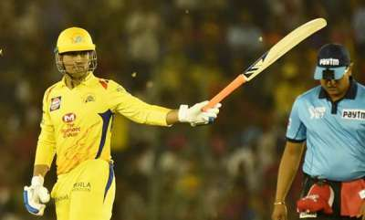sports-news-fan-touches-ms-dhonis-feet-when-he-came-on-to-bat-agianst-rajasthan-royals
