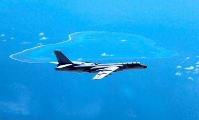 latest-news-china-lands-bomber-on-south-china-sea-island-for-first-time