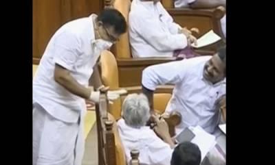 kerala-assembly-uproar-over-mlas-mask-and-glouse