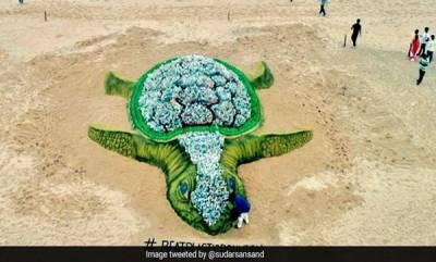world-sand-artist-creates-big-sand-turtle-on-world-environment-day