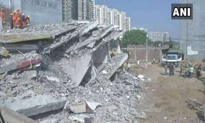 india-under-construction-building-collapses-in-noida-2-killed-many-feared-trapped