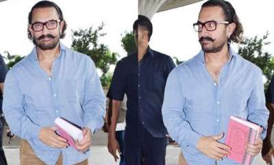 chit-chat-aamir-khan-spotted-reading-mahabharata-at-airport