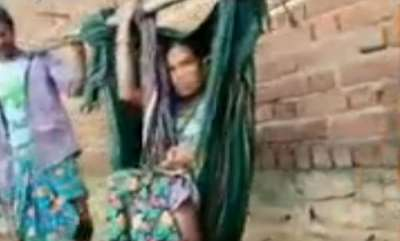 latest-news-woman-carried-on-pole-delivers-in-open-man-hopes-video-will-shake-netas