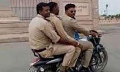 latest-news-police-ride-bike-without-helmet