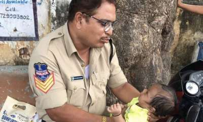 latest-news-cop-babysits-while-mother-writes-exam