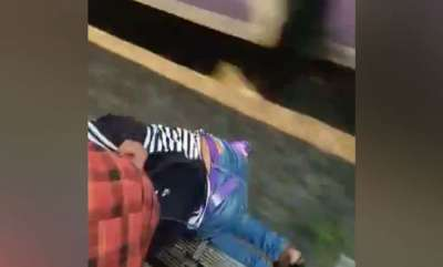 latest-news-teen-slips-off-train-commuters-grab-t-shirt-to-pull-her-up