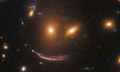 odd-news-nasa-spots-emoji-in-space-as-hubble-telescope-reveals-smiley-face-galaxy-cluster
