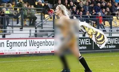 sports-news-women-runs-football-pitch
