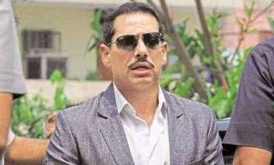 latest-news-raids-at-premises-linked-to-robert-vadra-congress-says-vendetta