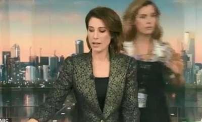 latest-news-news-anchor-hair-dressing-on-live-news-reading
