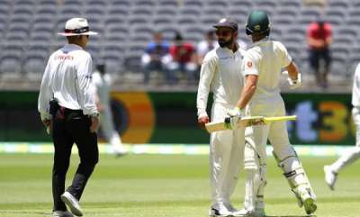 sports-kohli-paine-resume-verbal-duel-umpire-issues-a-warning