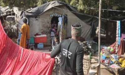 latest-news-huts-of-poor-covered-with-curtains-ahead-of-pm-modi-rally