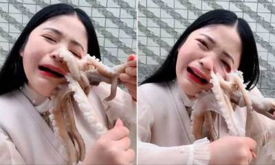 environment-blogger-tries-to-eat-octopus-alive-it-latches-onto-her-and-fights-back