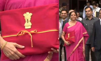 latest-news-nirmala-sitharaman-carries-budget-documents-in-red-cloth-with-national-emblem-ribbon