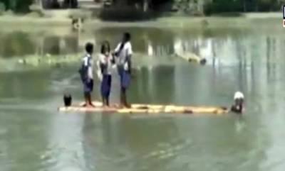 latest-news-assam-students-cross-a-river-on-banana-stems-to-reach-their-school
