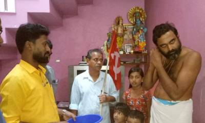 mangalam-special-chief-priest-of-a-temple-gives-ear-ring-to-cmrd