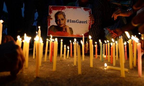 uploads/news/2018/09/246137/gauri lankesh candle.jpg
