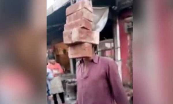 surprise-look-ma-no-hands-man-lifts-6-bricks-with-his-teeth-in-amazing-video