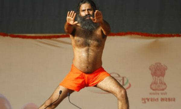 Image result for Baba Ramdev conducts yoga session in Tihar Jail